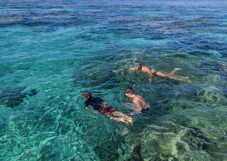 A family snorkeling in New Caledonia