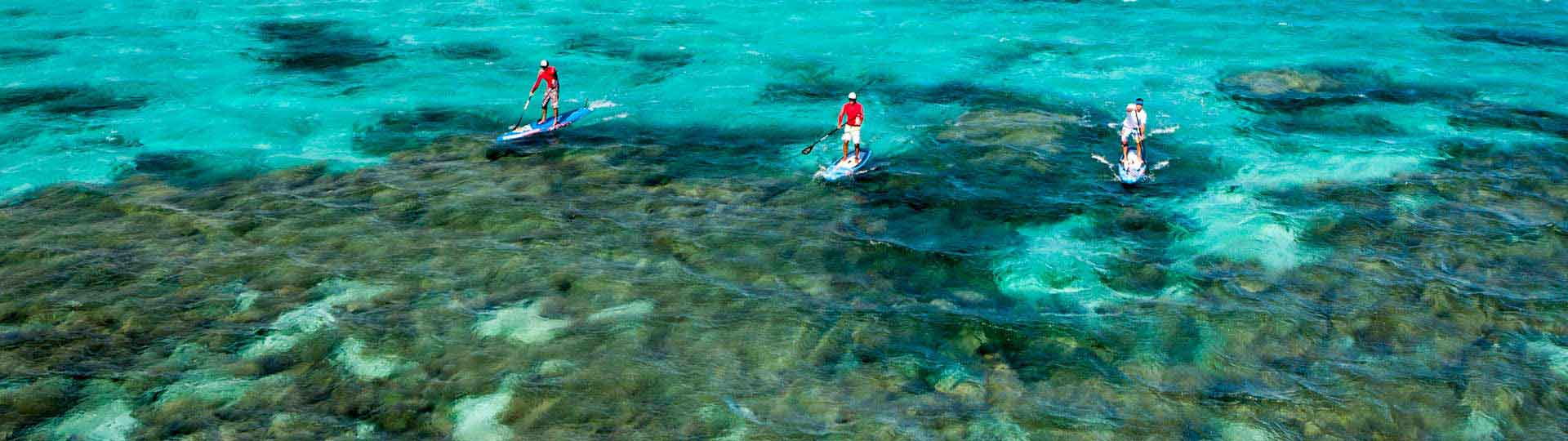 Stand up paddle on the lagoon in New Caledonia