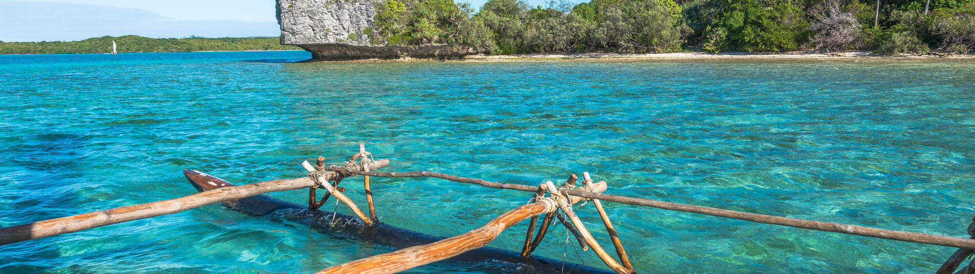 Outrigger canoe on the lagoon in the Isle of Pines